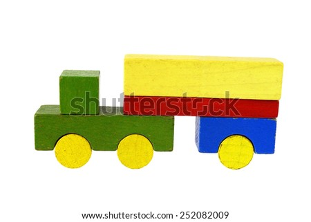 Camion of wooden blocks, traditional toy on white background - stock photo
