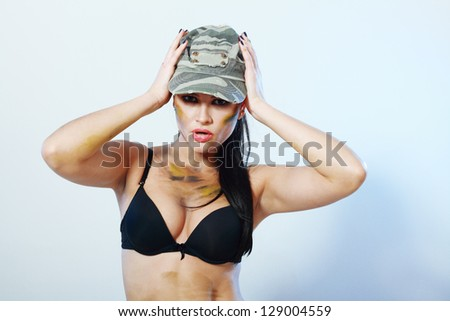 camo girl female fighter looking  aggressive over dark background - stock photo