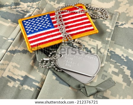 Camouflage American Flag patch and dog tags - stock photo