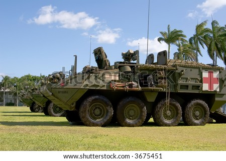 Camouflage Army Strykers with the Medic configuration in front - stock photo