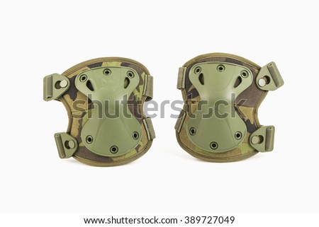 Camouflage knee pads of knee protectors on white background. - stock photo