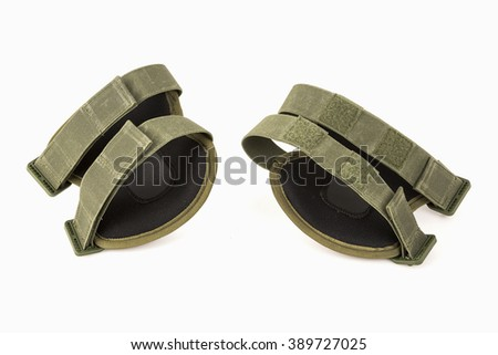 Camouflage knee pads of knee protectors on white background. Back side - stock photo
