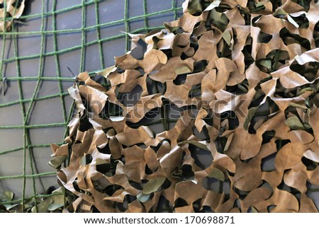 Camouflage netting for military or hunting use - stock photo