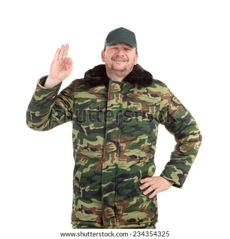 Camouflage winter jacket with black collar. Isolated on a white background.