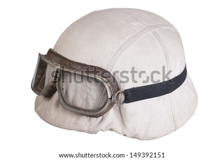 camouflaged nazi german helmet with protective goggles - stock photo