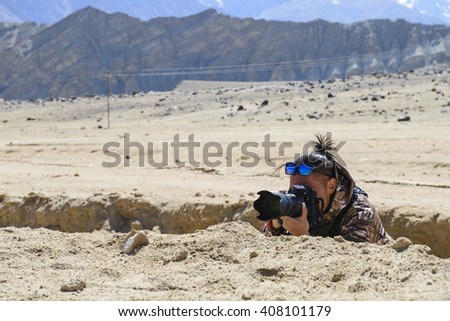 Camouflaged photographer