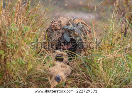 camouflaged sniper - stock photo