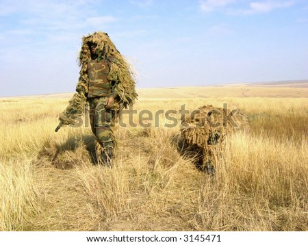 Camouflaged Soldier Aiming. Snipers. Army - stock photo