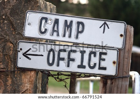 Camp and office signs on gate - stock photo