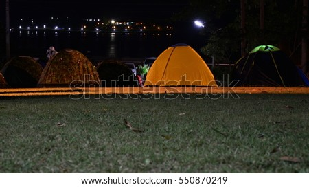 camp in forest at night near river