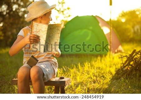 Camp in the tent - young boy on a camping - stock photo