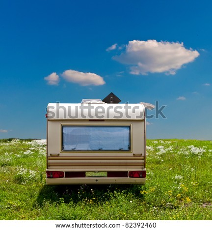 Camp mobile on a meadow with a blue sky background - stock photo