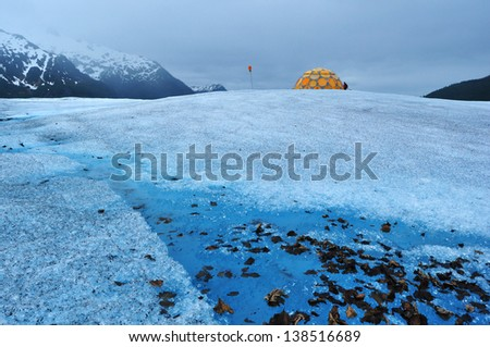Camp on Top of Mendenhall Glacier in Juneau Ice Field - stock photo