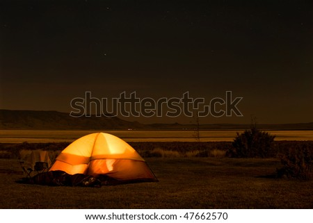 Camp site with illuminated tent in the wild, Oregon - stock photo