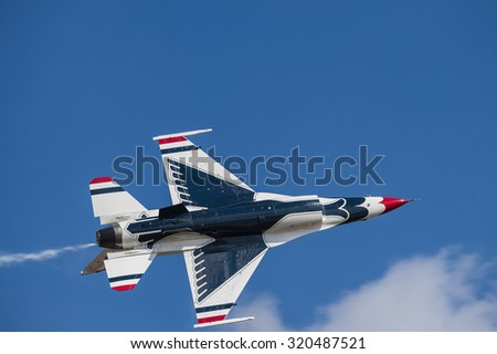 CAMP SPRINGS, MD, USA - SEPTEMBER 19, 2015: The USAF Thunderbirds perform during the 2015 Joint Base Andrews Air Show held at Joint Base Andrews in Camp Springs Maryland.