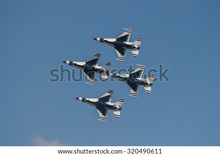 CAMP SPRINGS, MD, USA - SEPTEMBER 19, 2015: The USAF Thunderbirds perform during the 2015 Joint Base Andrews Air Show held at Joint Base Andrews in Camp Springs Maryland. - stock photo