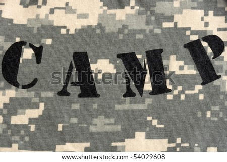 camp stamped on army universal military camouflage fabric, background digital style pattern, new fabric - stock photo