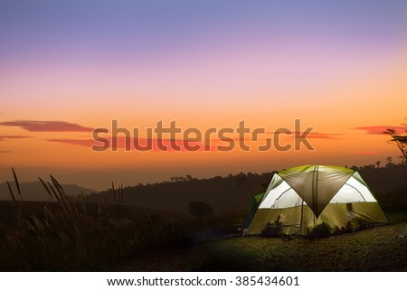camp with tent, sunset time with rising sun