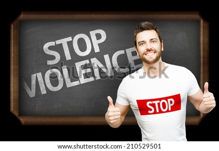 Campaign against Violence by a man on blackboard background - stock photo