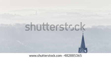 campaign, bell tower and town in winter