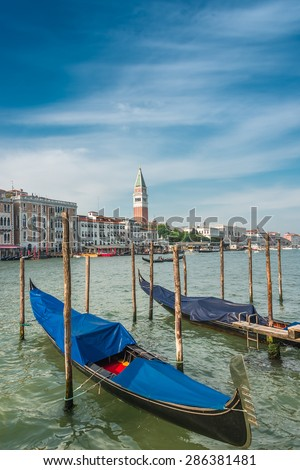 Campanile tower at Piazza San Marco and gondolers, Venice, Italy, 2015 - stock photo