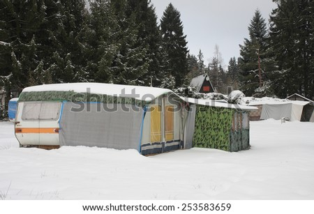 camper covered by snow in winter - stock photo