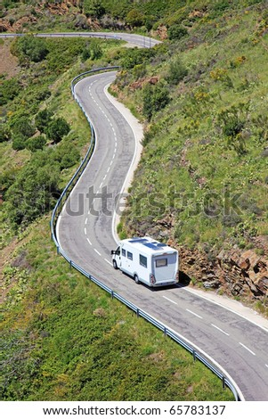 Camper on the road near border between Spain and France. - stock photo