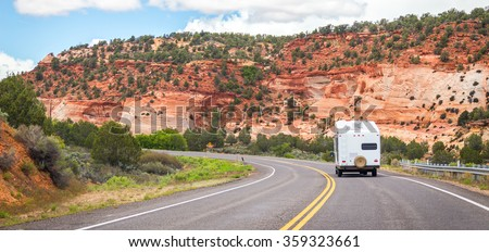 Camper on the road to Bryce canyon, USA, motorhome trailer - stock photo
