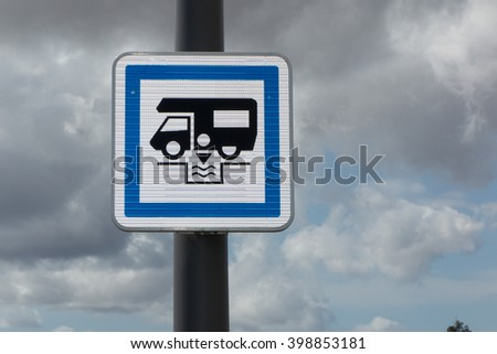 Camper sign in Europe, blue sign on a pole for dumping station - stock photo