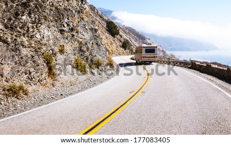 Camper van on the highway one curvy road - stock photo