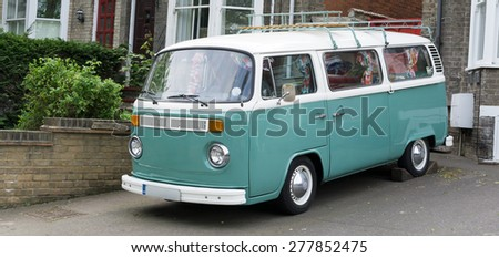Camper Van parked outside a house. - stock photo
