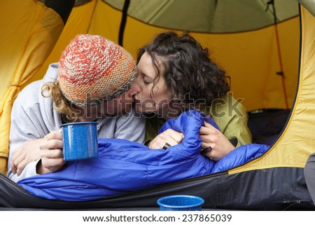 Campers Kissing - stock photo