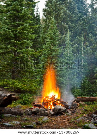 Campfire at Wilderness Campsite in the Rocky Mountains, Colorado - stock photo