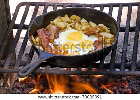 Campfire breakfast of eggs,bacon and potatoes - stock photo