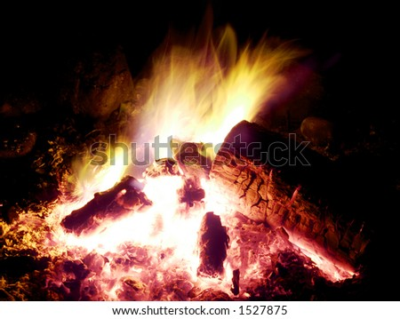 Campfire Glows in the Night - stock photo
