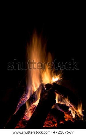 Campfire in the night with black background