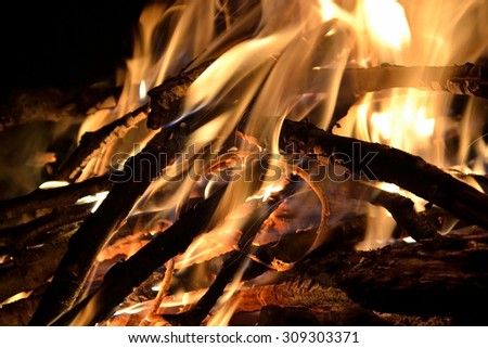 Campfire with flame at night. - stock photo