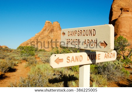 Campground Sign Post In Rocks With Blue Sky
