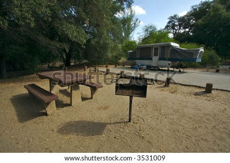 Campground Picnic Table Barbecue Pit Tenttrailer Stock Photo - Picnic table trailer