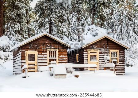 camping cabins in winter, Custer State park, S.Dakota - stock photo