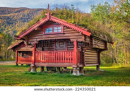 Camping cabins with turf roof near Hallingskarvet National Park in Norway - stock photo