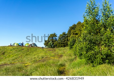 camping camp site with blue sky - stock photo