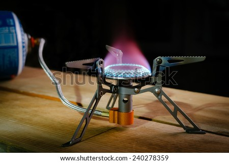 camping equipment, portable gas burner - stock photo
