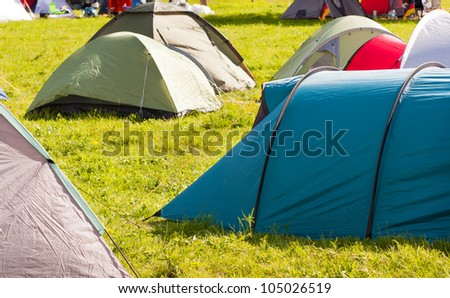 Camping full of tents and vacationer - stock photo