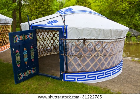 Camping in an authentic white and blue yurt - stock photo