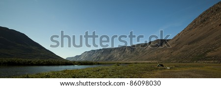 Camping in arctic tundra, Greenland - stock photo