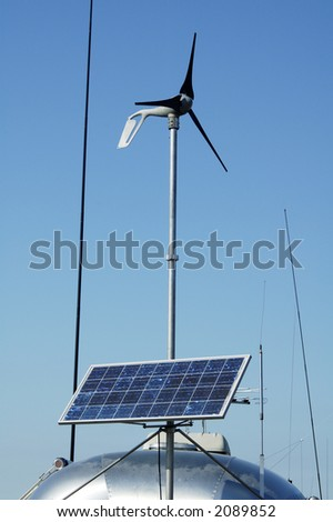 Camping in the desert with solar panels for converting energy from the sun to electricity. - stock photo