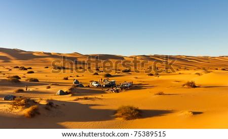 Camping in the Dunes of the Awbari Sand Sea, Sahara Desert, Libya - stock photo