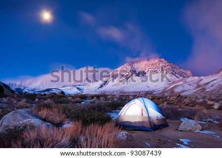 camping in the high mountains - stock photo