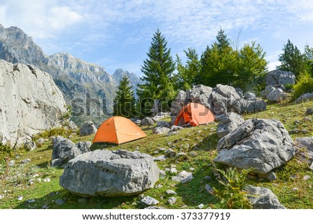 Camping in the mountains among the boulders. - stock photo